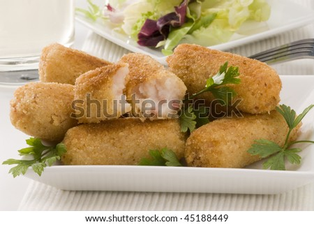 Spanish cuisine. Ham croquettes. Selective focus. Croquetas de jamon. - stock photo