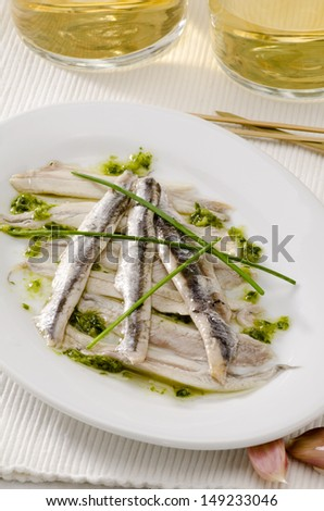 Spanish cuisine. Tapas. Marinated fresh anchovies in sauce. Selective Focus. Boquerones.