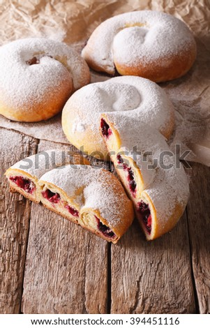 Spanish ensaimada pastries with berries close-up on the table. vertical - stock photo