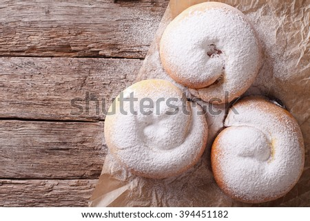 Spanish ensaimada pastries with berries on the table. Horizontal view from above - stock photo
