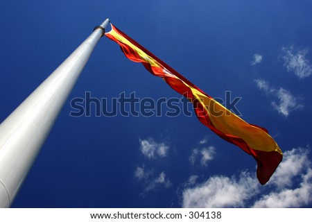 Spanish flag blowing in the wind - stock photo