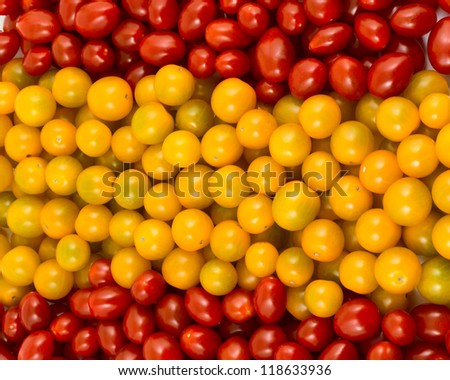 Spanish flag formed of cherry tomatoes - stock photo