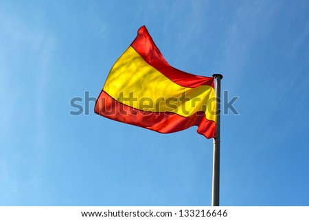 Spanish flag in the wind against the sky