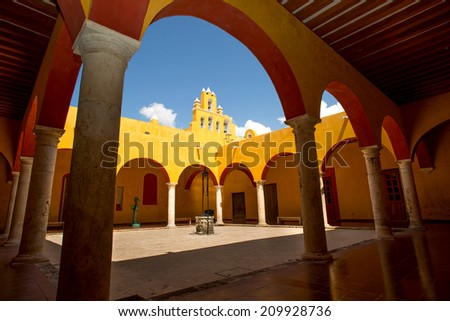 Spanish interior courtyard with arches - stock photo