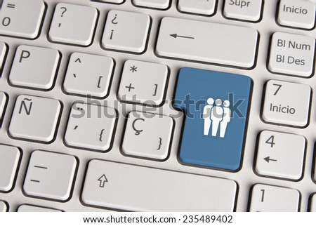 Spanish keyboard with social media community icon over blue background button. Image with clipping path for easy change the key color and editing. - stock photo