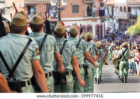 Spanish legionnaires marching during an Easter parade - stock photo