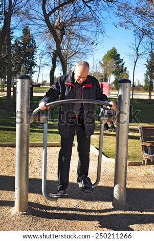 Spanish man has been at the gym in the park - stock photo