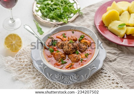 Spanish meatballs albondigas in tomato sauce with mushrooms - stock photo
