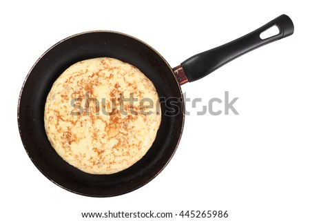 Spanish omelette in frying pan. Isolated with clipping path. Directly Above. - stock photo