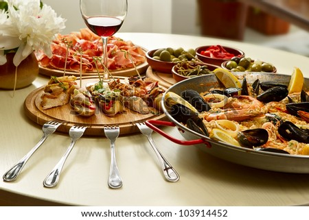 Spanish paella dinner on the table - stock photo
