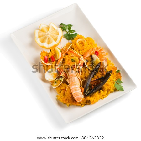 Spanish paella with shrimp and mussel on a white dish isolated over white background.  - stock photo