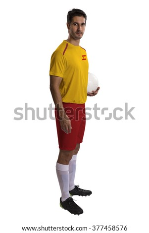 Spanish soccer player holding ball on white background.