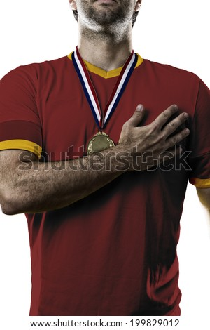 Spanish soccer player, listening to the national anthem with his hand on his chest. On a white background.