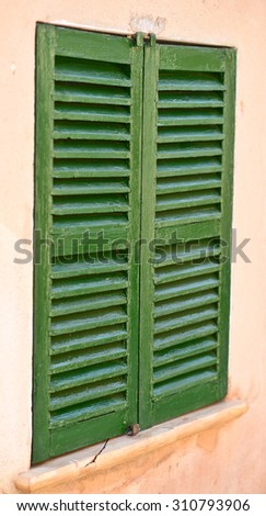 Fire shutter housing window stock photo 480601417 for Spanish style window shutters