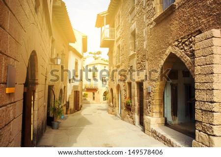 Spanish suburban street at sunset - stock photo