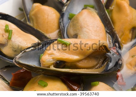 Spanish tapas.Mussels in white wine and garlic sauce. Typical appetizer. Closeup. - stock photo