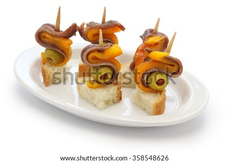 spanish tapas pinchos, anchovy olive and paprika - stock photo