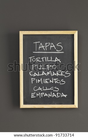 Spanish tapas sketched on chalkboard - stock photo