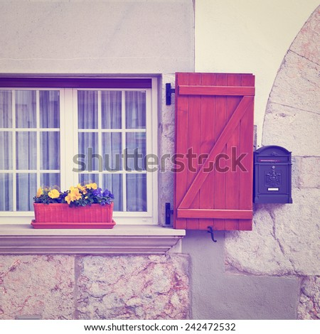 Spanish Window with Open Wooden Shutters, Decorated With Fresh Flowers, Instagram Effect - stock photo