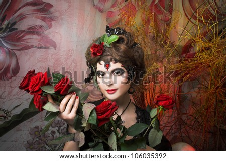 Spanish woman. Young woman in black with artistic visage and with rose in her hair