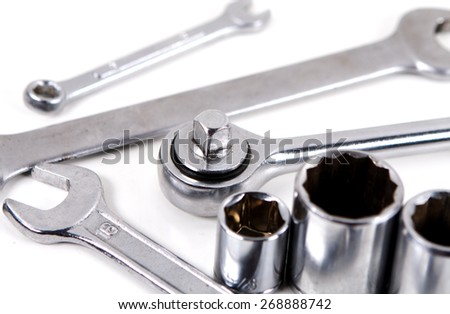 Spanners and sockets over white - stock photo