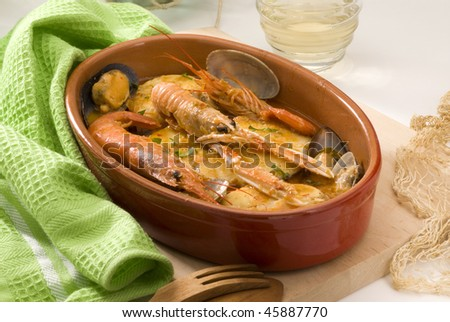Spannish cuisine. Catalan fish stew. Served in a ceramic plate. Zarzuela de peix. - stock photo
