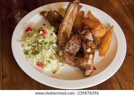 spare ribs with lettuce and fried potato - stock photo