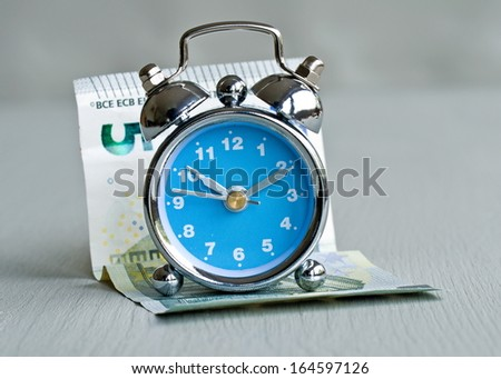 spare time and money - stock photo