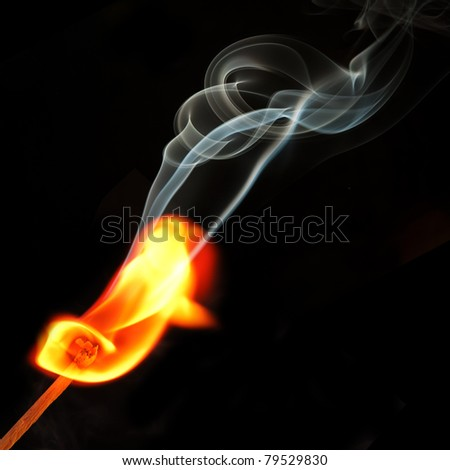 Spark of match with fire and smoke on black background