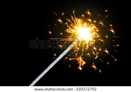 Sparking Bengal fires on black background close-up. - stock photo