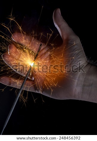 Sparkler and hand - stock photo