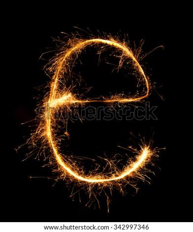 Sparkler firework light alphabet e (Small Letters) at night background - stock photo