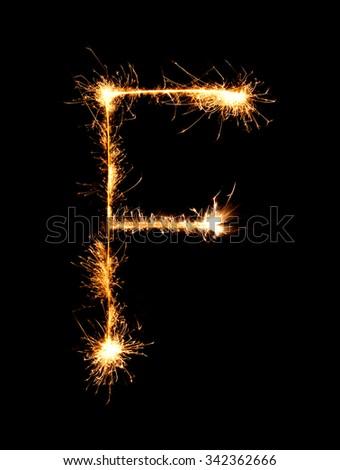 Sparkler firework light alphabet F (Capital Letters) at night background - stock photo