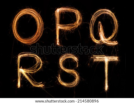 Sparkler firework light alphabet O-T - stock photo