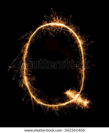 Sparkler firework light alphabet Q (Capital Letters) at night background - stock photo