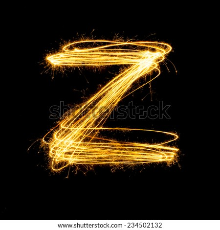 Sparkler firework light alphabet Z with uppercase isolated on black background. - stock photo