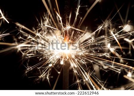 sparkler on black - stock photo