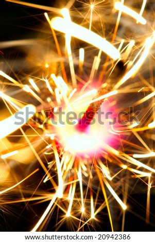 Sparkler on fire close-up over black background