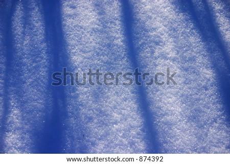 Sparkles on the undisturbed snow in the sunlight - stock photo