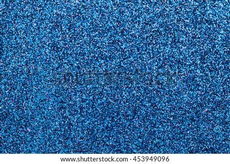 Sparkling background of dark blue small sparkles closeup. Brilliant backdrop. - stock photo