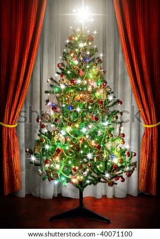 sparkling Christmas tree in a room next to window curtains - stock photo