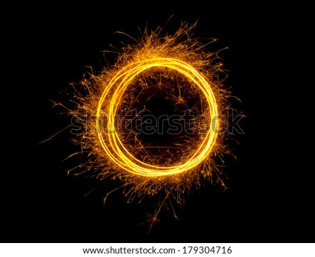 Sparkling glowing fire ring isolated on black background