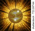 Sparkling gold disco ball on a light burst background with mosaic detail - stock photo