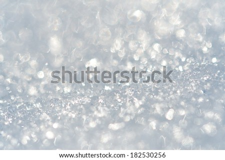 Sparkling light background. Snow picture close up with the shallow depth of field. - stock photo