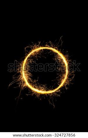 Sparkling light circle isolated on black background.  - stock photo