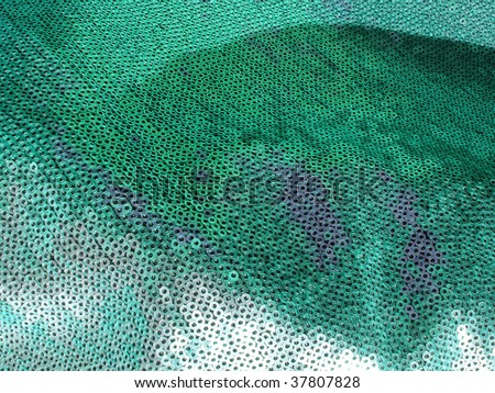 Sparkling sequined texture closeup. More of this motif & more textiles in my port. - stock photo
