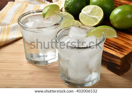 Sparkling water with fresh lime juice as a summer cooler - stock photo