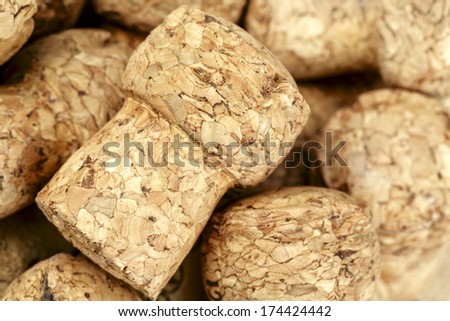 Sparkling wine bottle cork, shown close up against background to other corks - stock photo