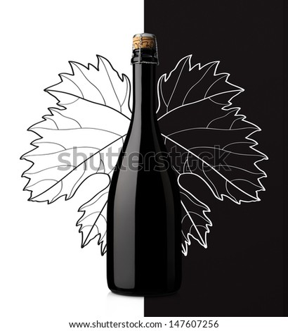 sparkling wine with grape leaf on white and black background - stock photo