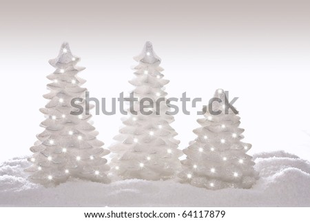 Sparkly glitter Christmas trees in silver and white. - stock photo